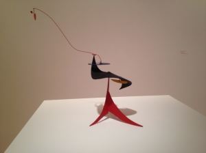 Woman's hat Calder mobile sculpture steel construction Whitney museum